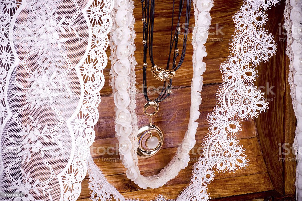 Vintage laces with jewelry royalty-free stock photo