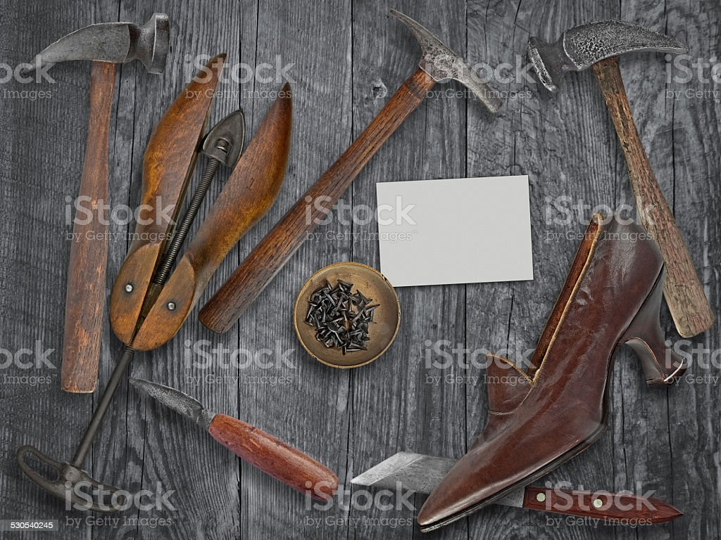 vintage ladies shoe and shoemakers tools stock photo