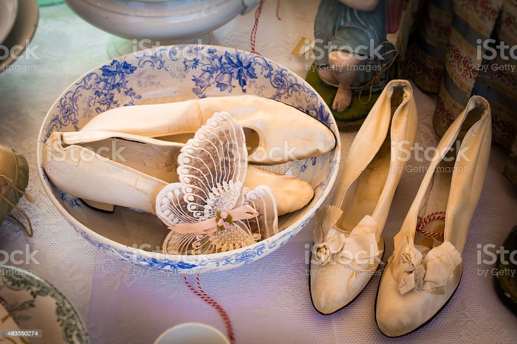 vintage ladies shoes  in a bowl on flea market stock photo