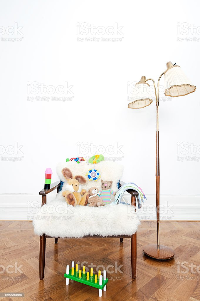 Vintage lamp and chair with toys royalty-free stock photo
