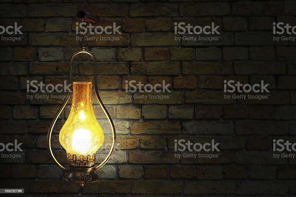 Vintage lamp near bricks wall royalty-free stock photo