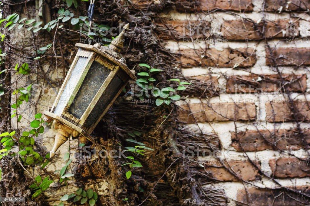 Vintage lamp on old brick wall stock photo