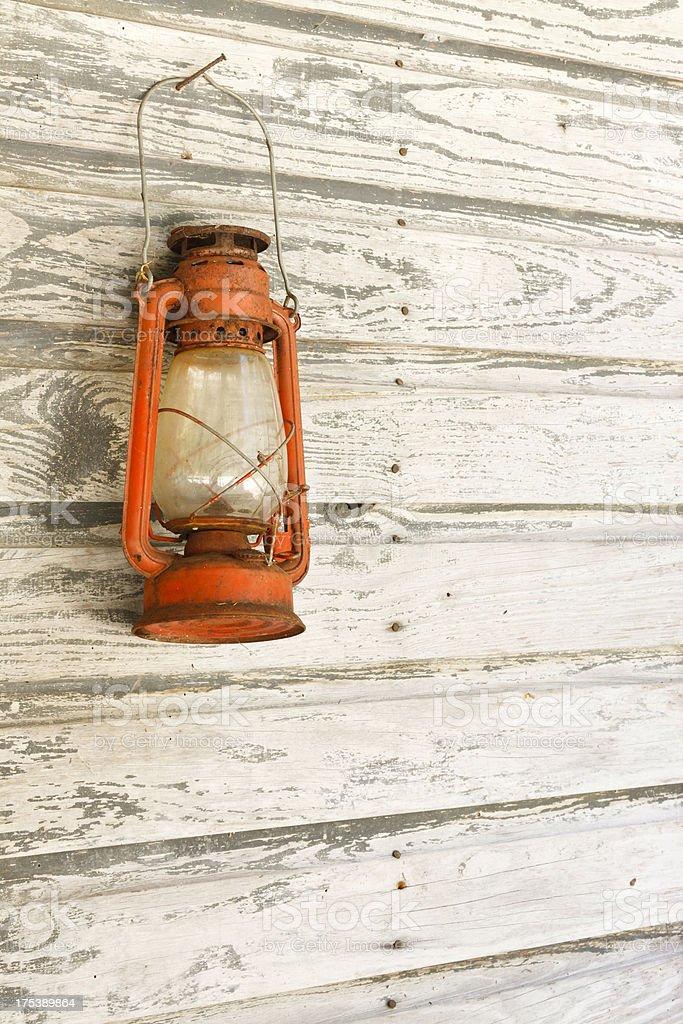 Vintage Lantern Hanging On Side of Rural Farmhouse stock photo
