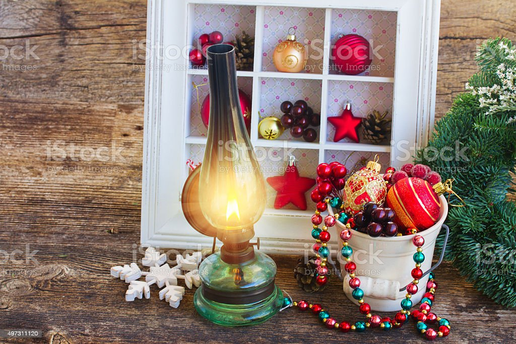 vintage lantern with christmas wreath stock photo