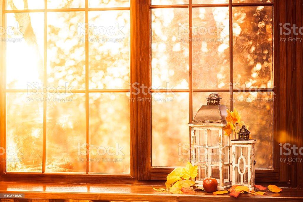 Vintage lanterns at the windowsill. Autumn background stock photo