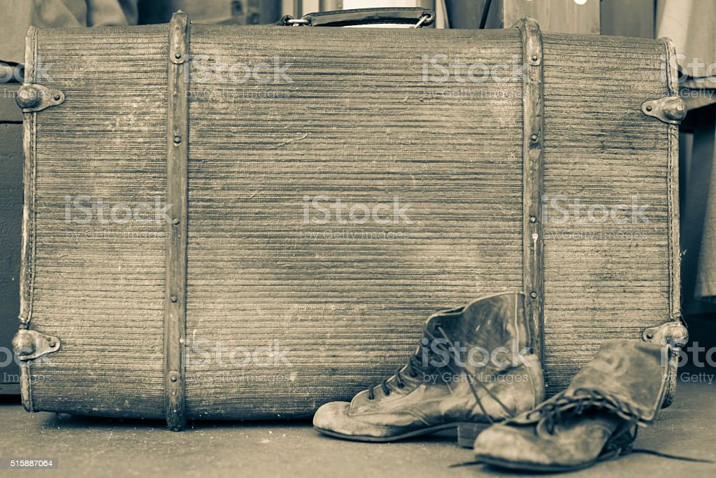 Vintage leather suitcase from the early 20th century. Side view. stock photo