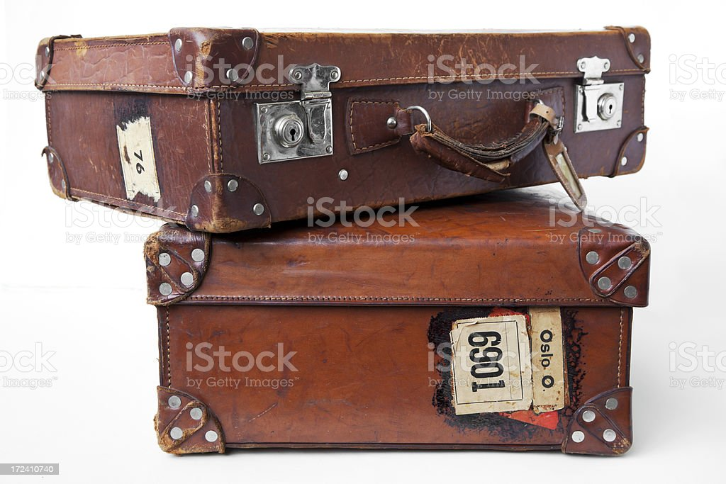 Vintage leather suitcases  with label lying on the floor. royalty-free stock photo