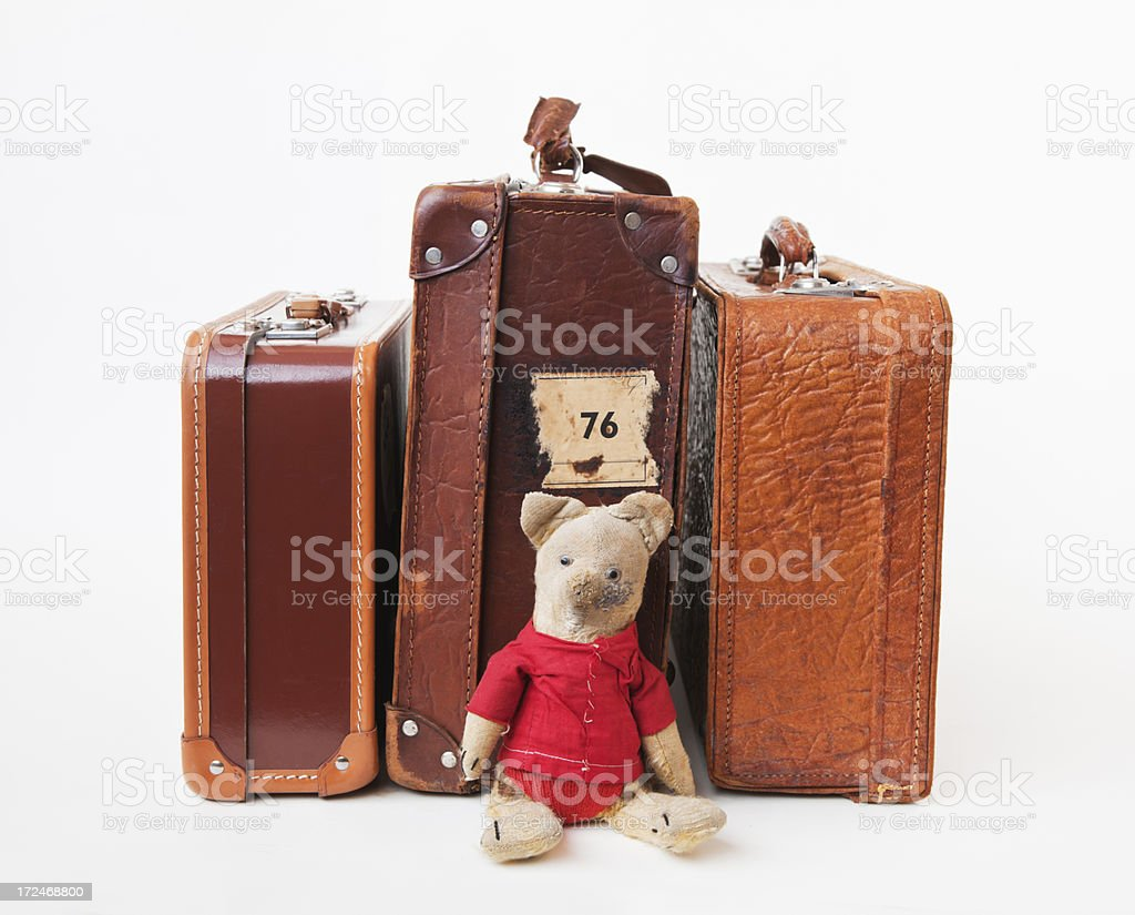 Vintage leather suitcases  with sitting plush teddy bear. royalty-free stock photo