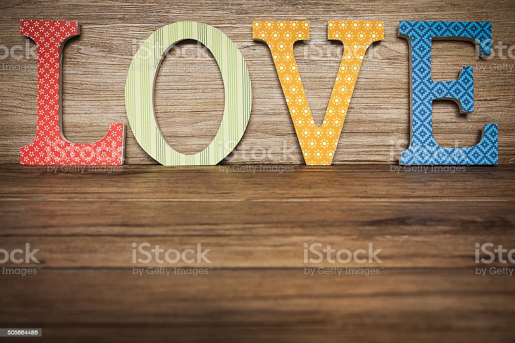Vintage letters Love over wood background with copy space stock photo