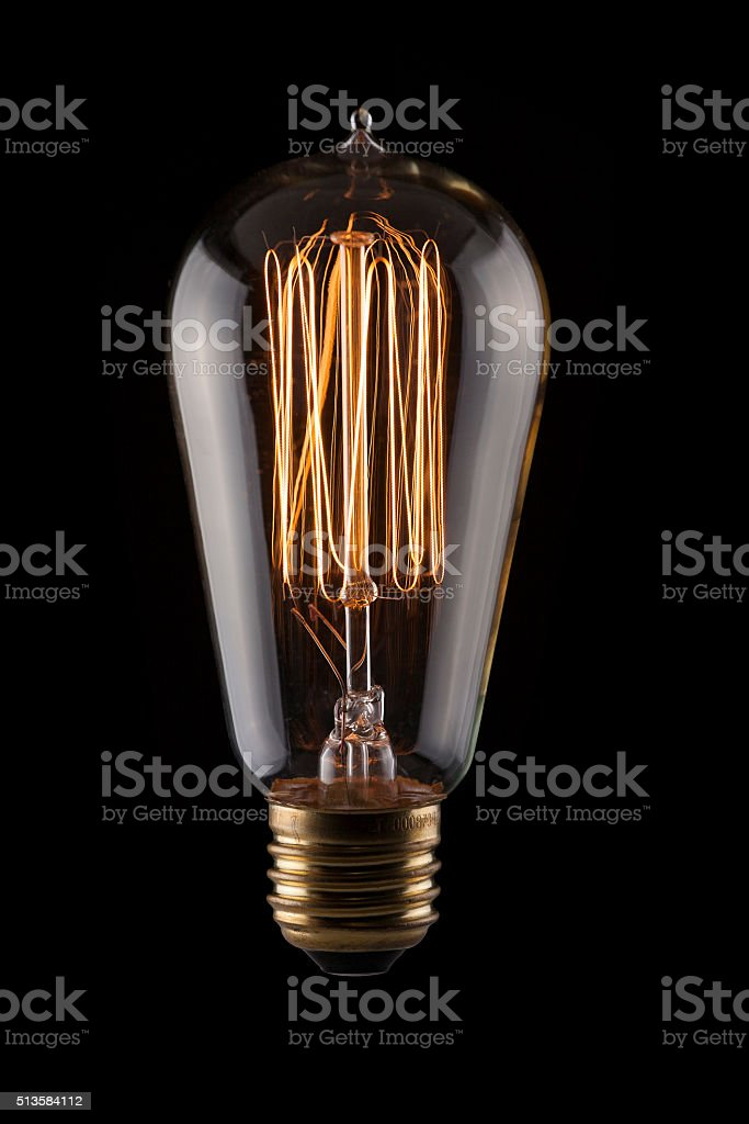 Vintage Light Bulb on Black Background stock photo