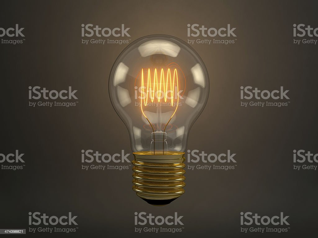 Vintage light bulb with glowing filament over dark background stock photo