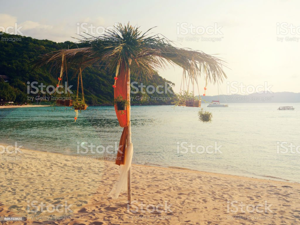 Vintage light effected: Beach umbrella exotic decoration with coconut tree stock photo