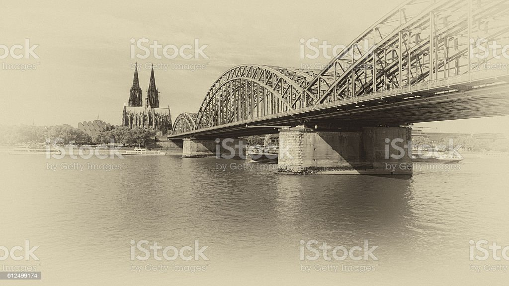 vintage like monochrome photo of Cologne Cathedral and Hohenzollern bridge stock photo