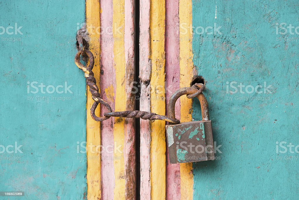 Vintage lock and chain on an door royalty-free stock photo