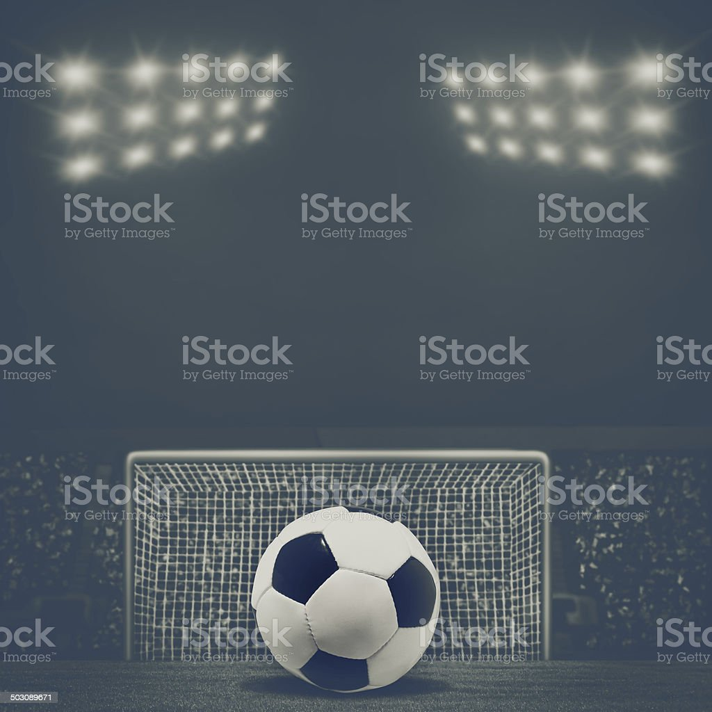 Vintage look sport backgrounds with soccer gate and ball stock photo