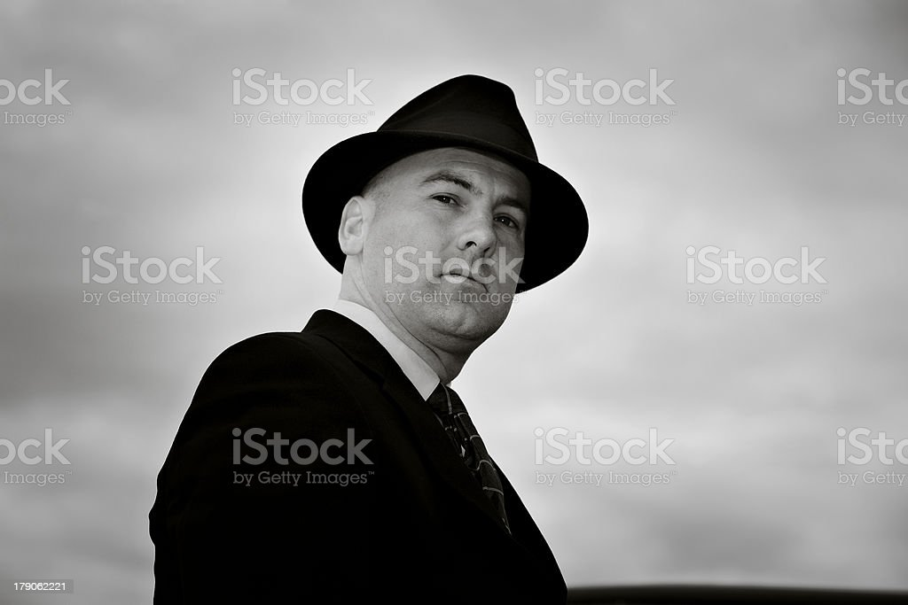 Vintage Looking Photo of a Man Wearing Fedora stock photo