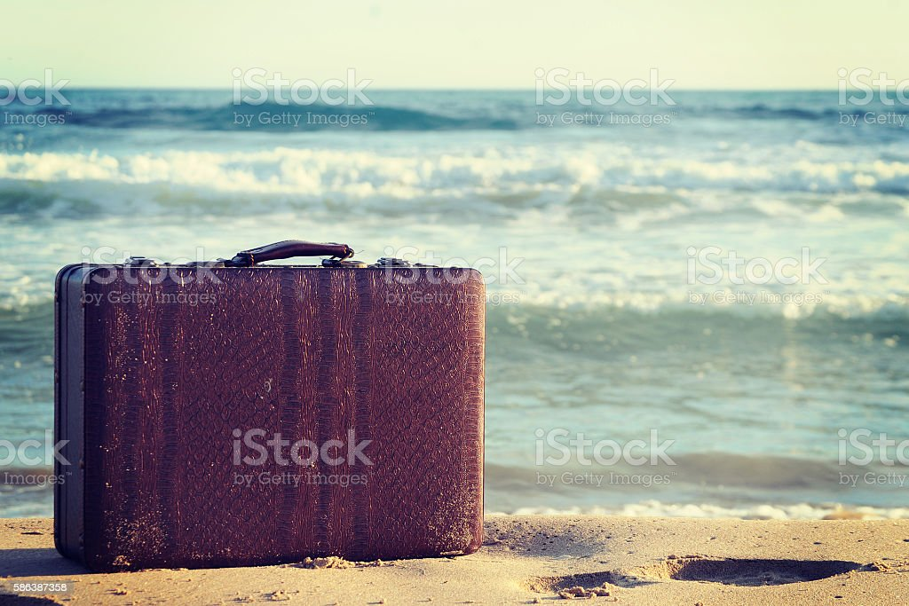 Vintage luggage at the near the sea stock photo