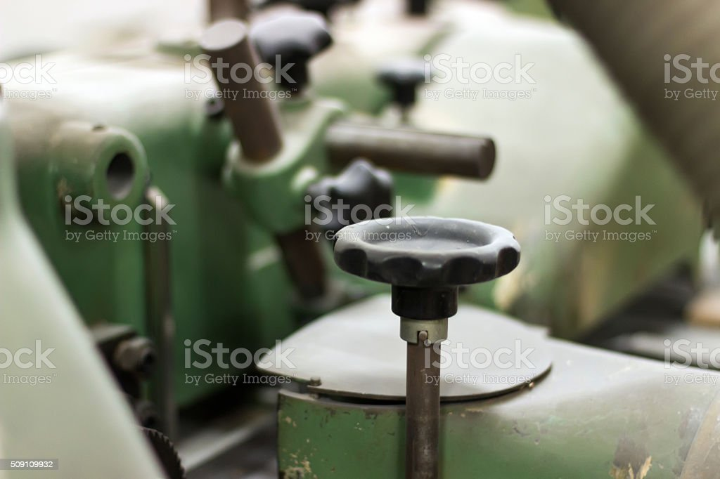 Vintage machine controls, Vintage machine screw handle stock photo