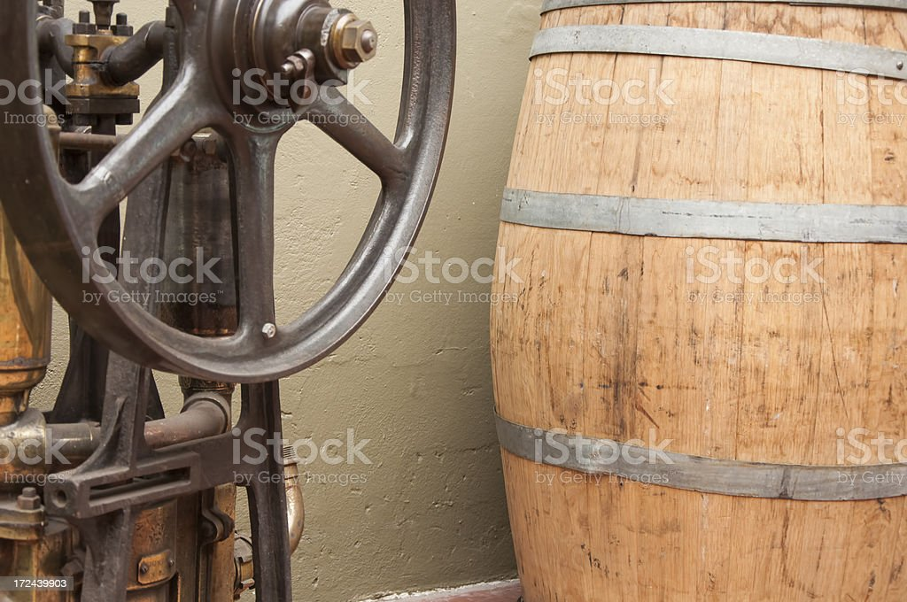 vintage machinery and wine barrel stock photo