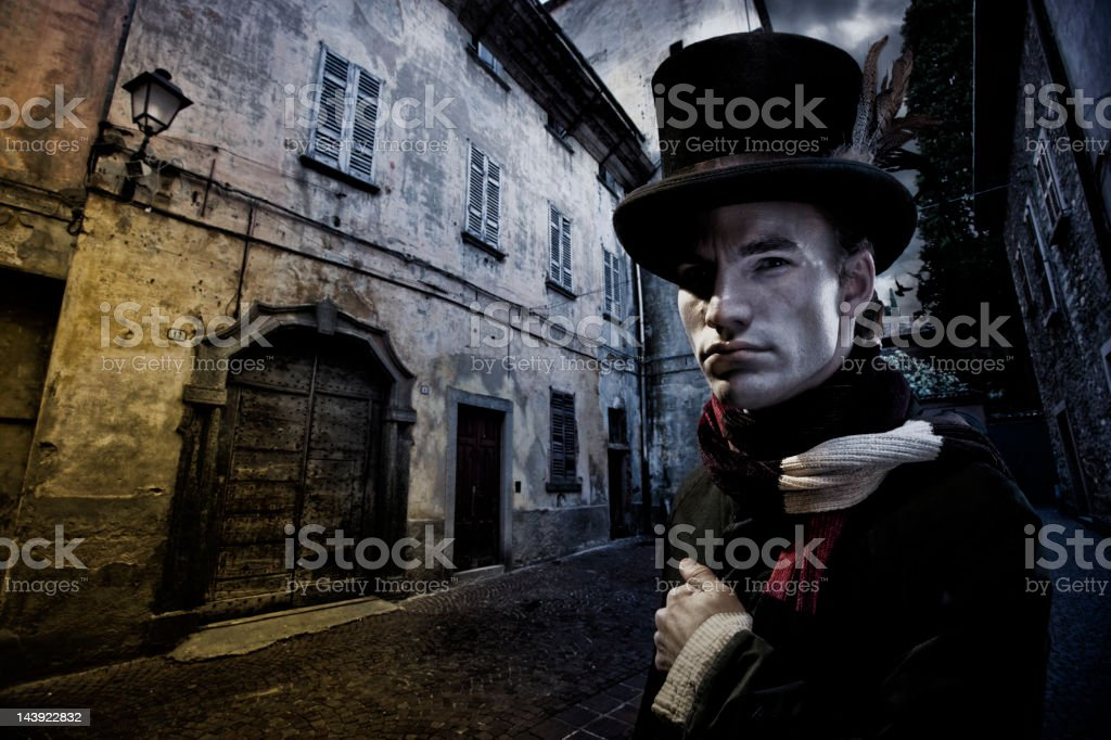 Vintage Man in tophat and Cobblestone Street stock photo