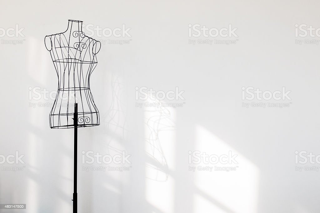 Vintage mannequin stand stock photo