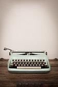Vintage Manual Typewriter on Wood Trunk, Light Teal