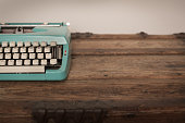 Vintage Manual Typewriter on Wood Trunk, Teal