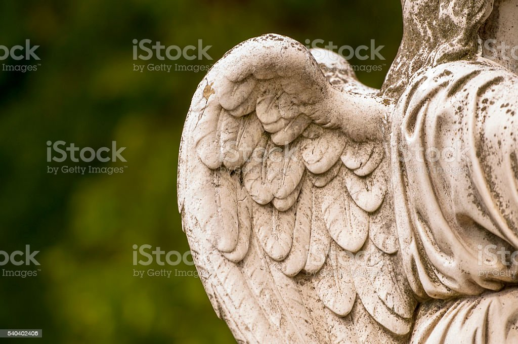 Vintage marble Angel at the old cemetery stock photo