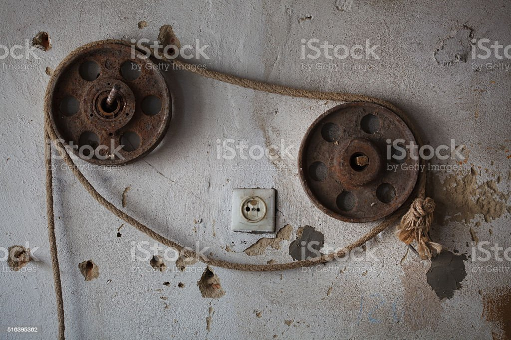 Vintage mechanism connected with rope. Industrial concept stock photo