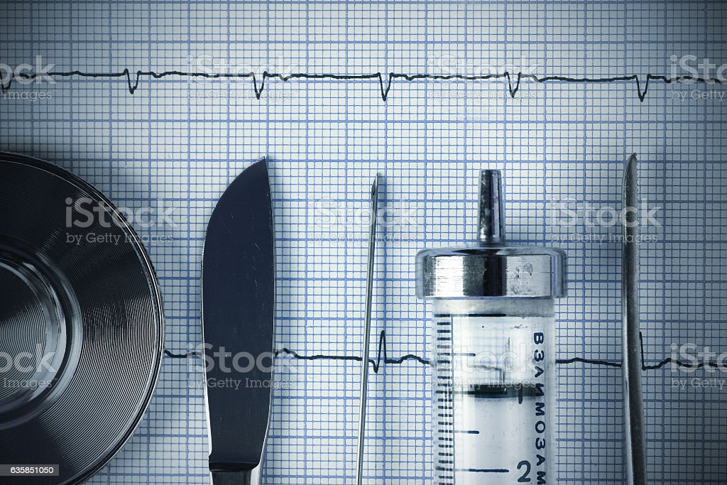 Vintage medical metal tools on the ECG graph stock photo