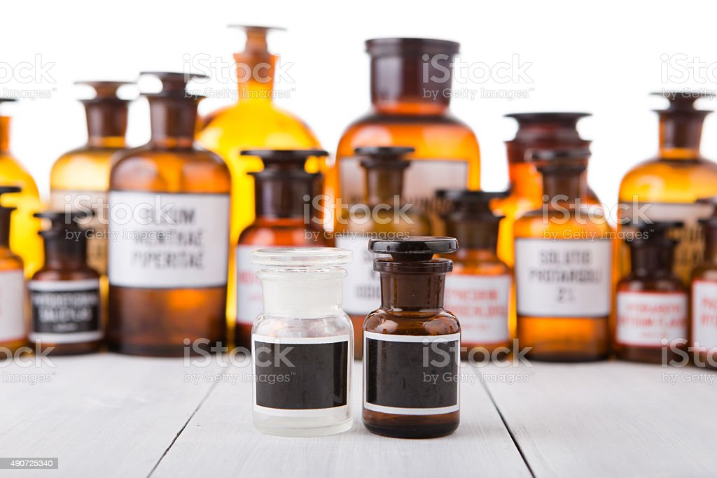 Vintage medicine bottle with blank label stock photo