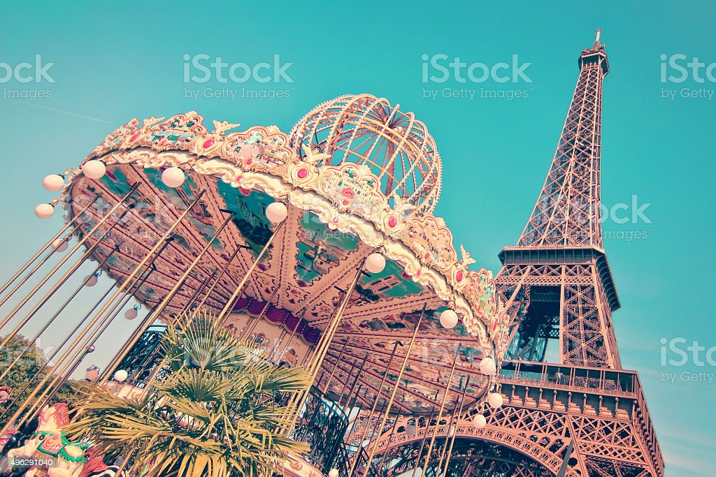 Vintage merry-go-round and the Eiffel tower, Paris France stock photo