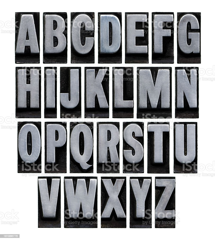 A vintage metal alphabet set on a white background royalty-free stock photo