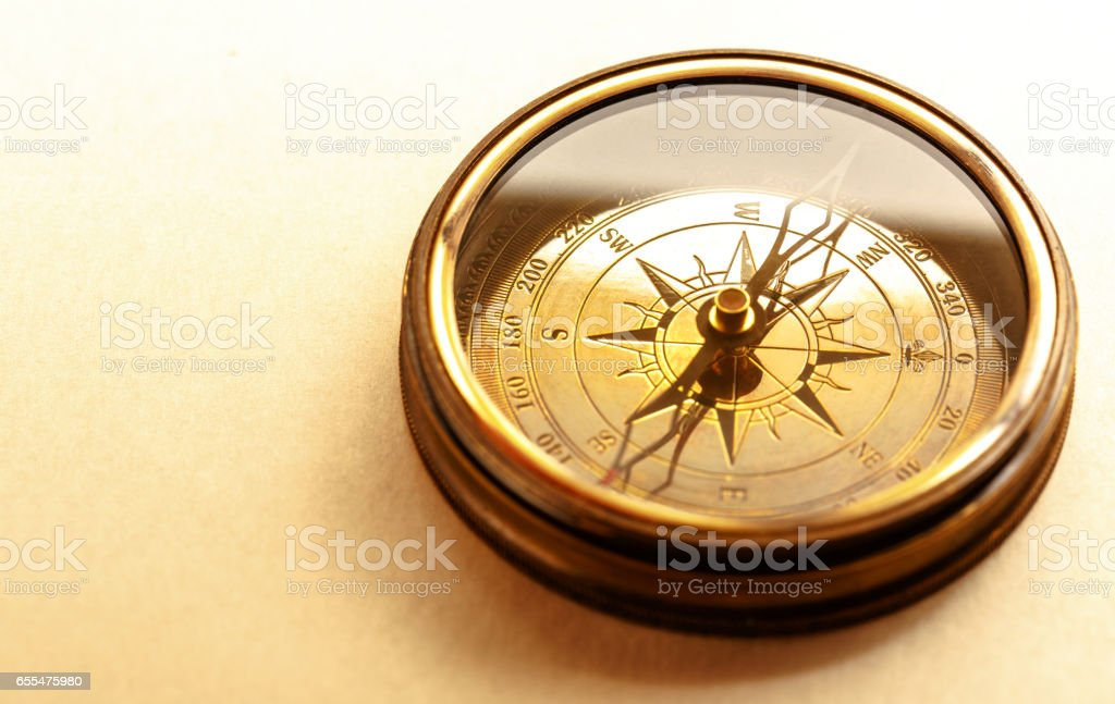 Vintage metal compass stock photo