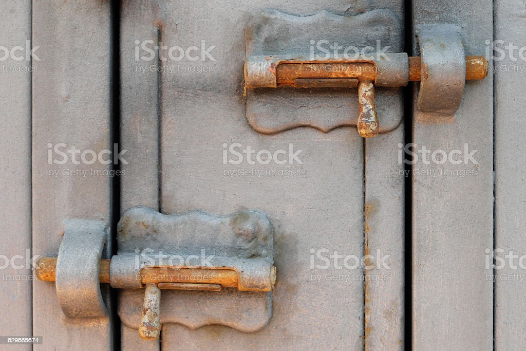 vintage metal ltch, locking bolt, locked door stock photo