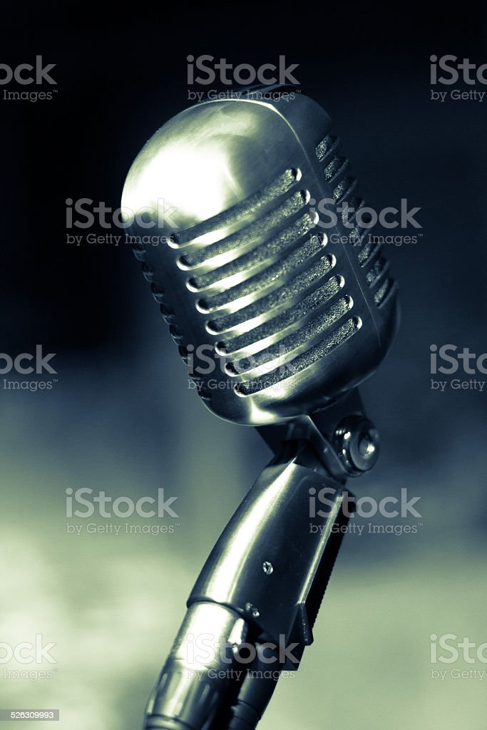 Vintage metal Microphone blue toned stock photo