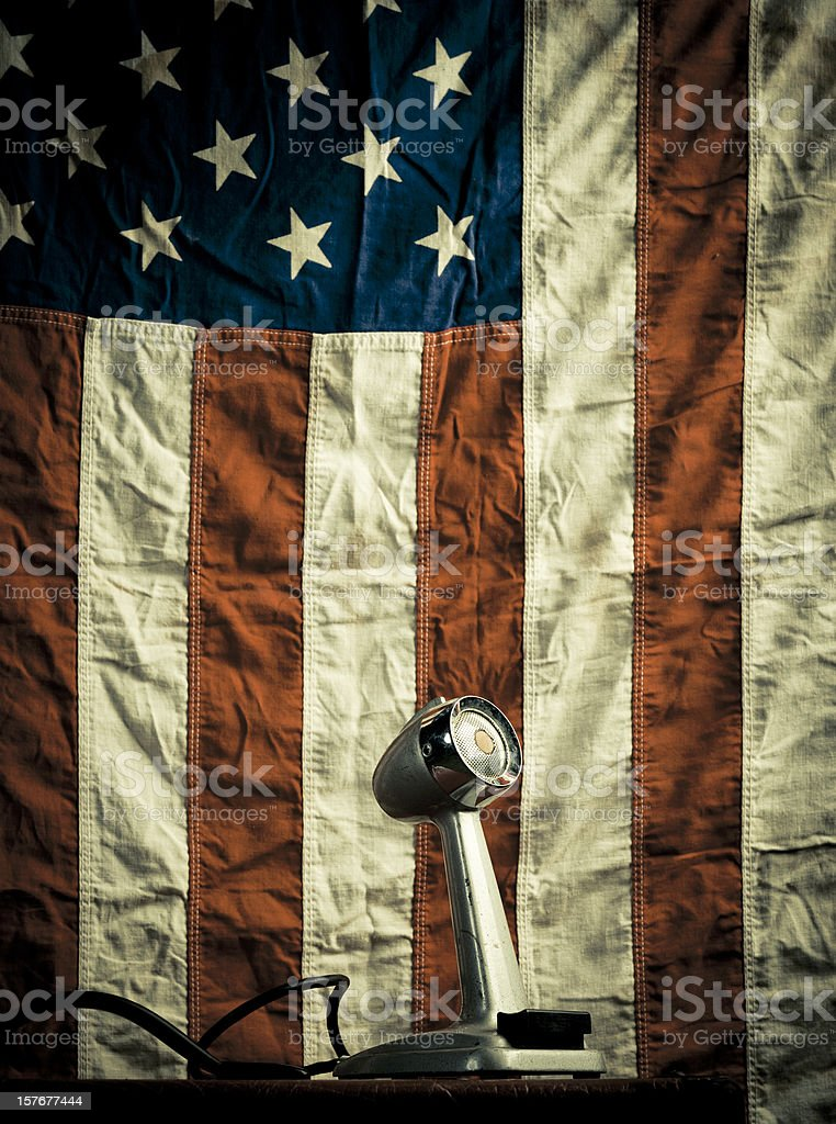 vintage microphone and american flag stock photo