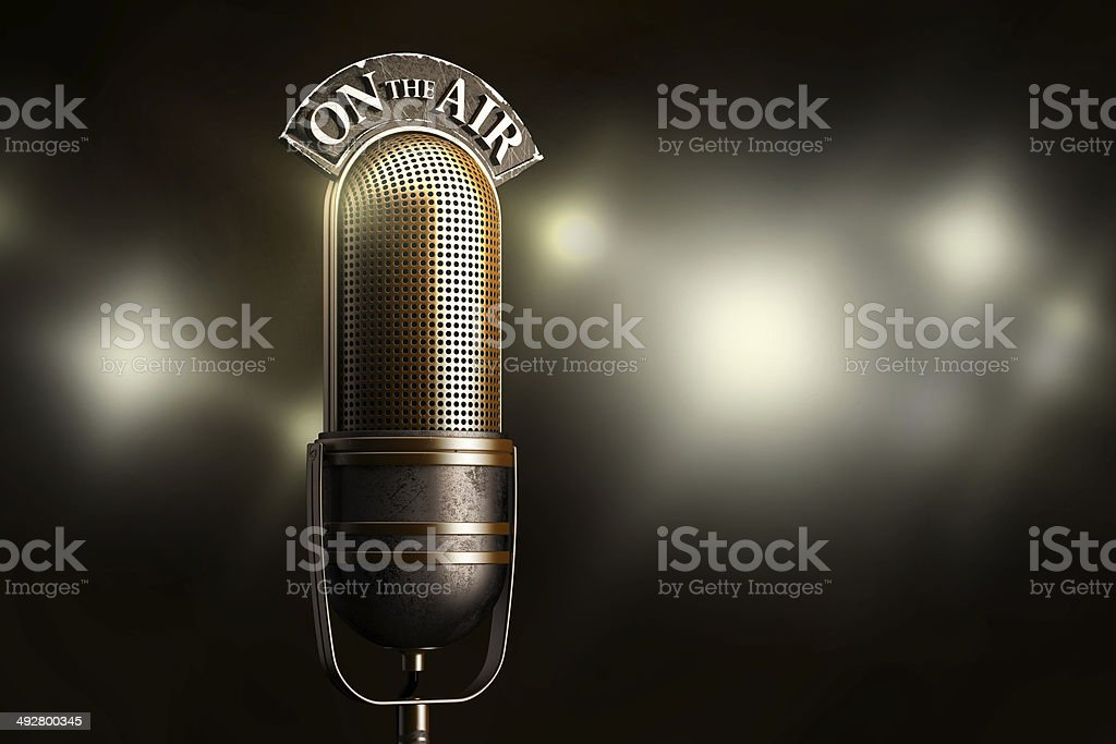 Vintage microphone illuminated by flash stock photo