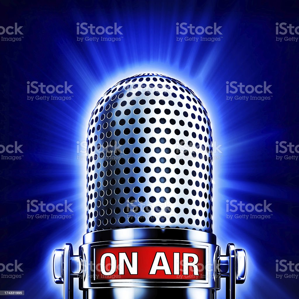 Vintage microphone on a bright blue background stock photo