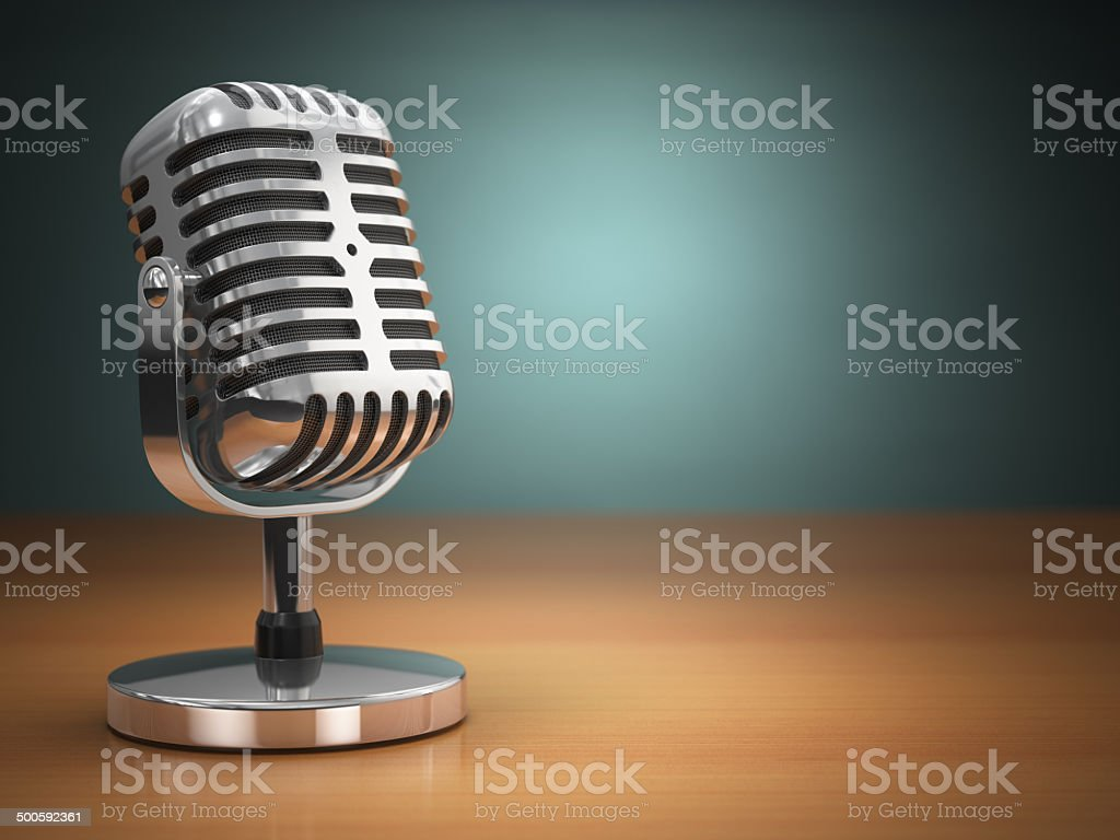 Vintage microphone on green background. Retro style. stock photo