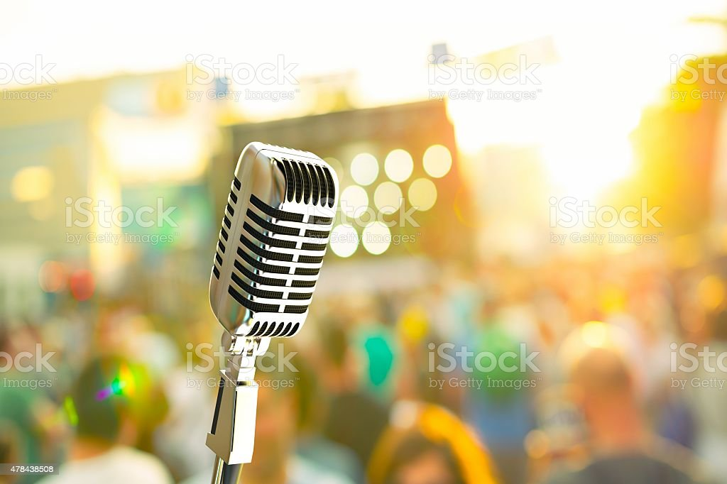 Vintage microphone on stage at a music festival stock photo