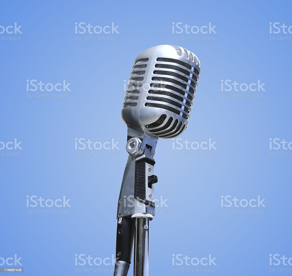 Vintage Microphone over blue background stock photo