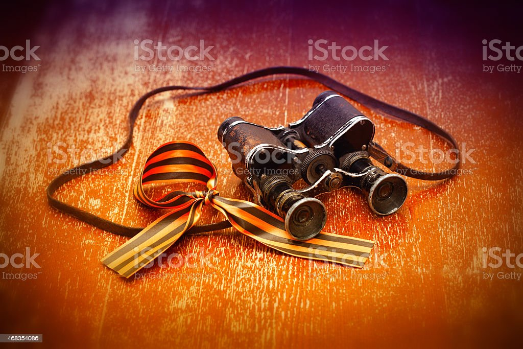 Vintage military binoculars and George Ribbon stock photo