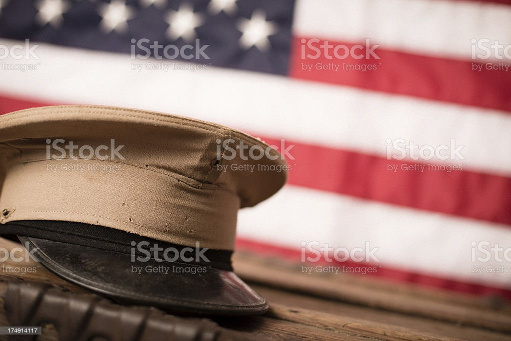 Vintage Military Hat in Front of American Flag stock photo