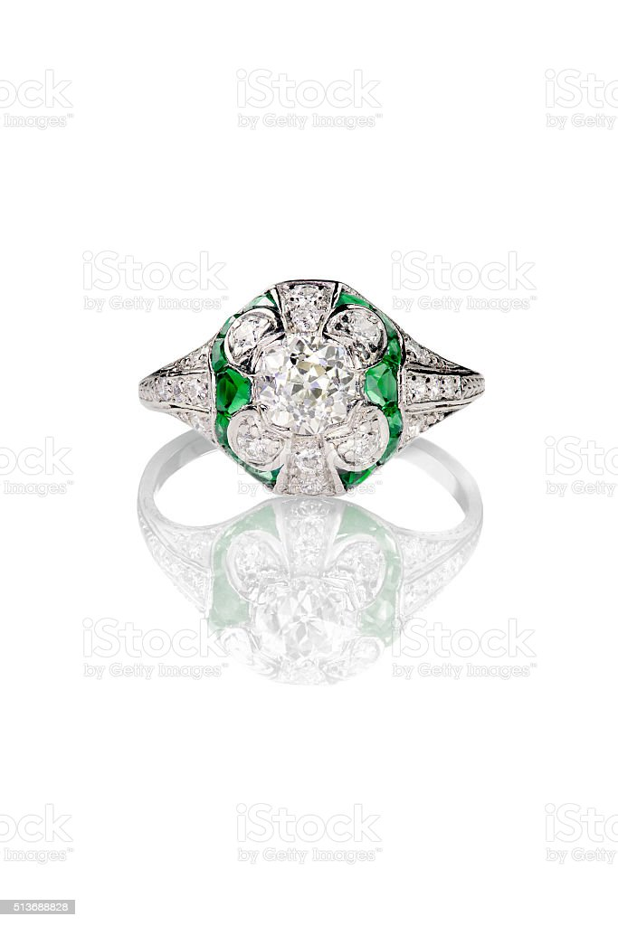 vintage mine cut engagement art deco ring with emerald stones stock photo
