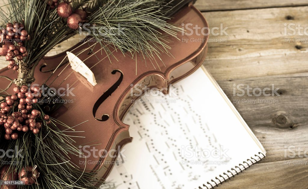 vintage monochrome image of violin with christmas decoration stock photo