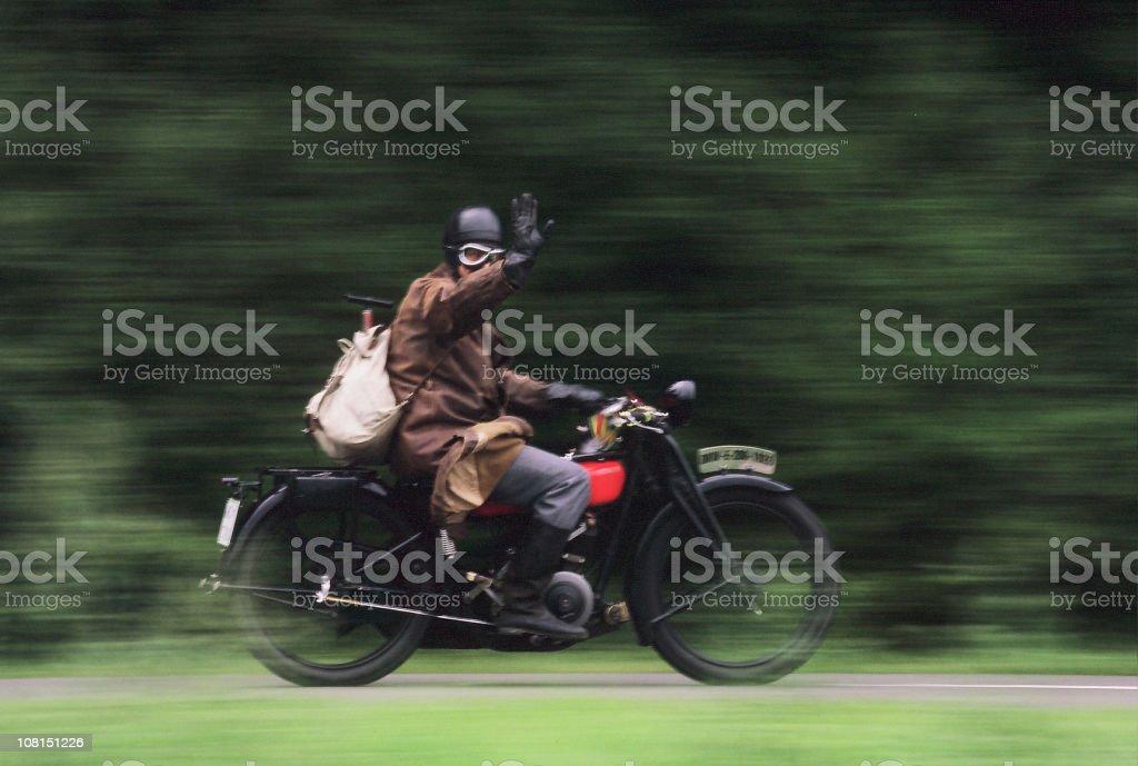 Vintage Motorcyclist, Motion Blur stock photo