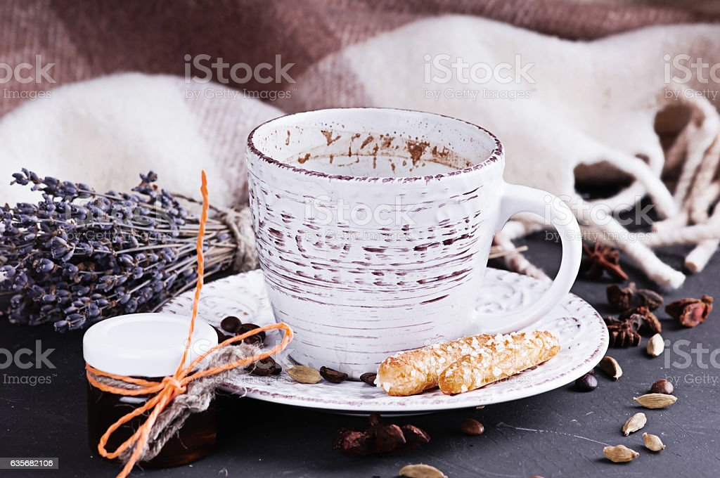 vintage mug with hot coffee and spices decorated stock photo