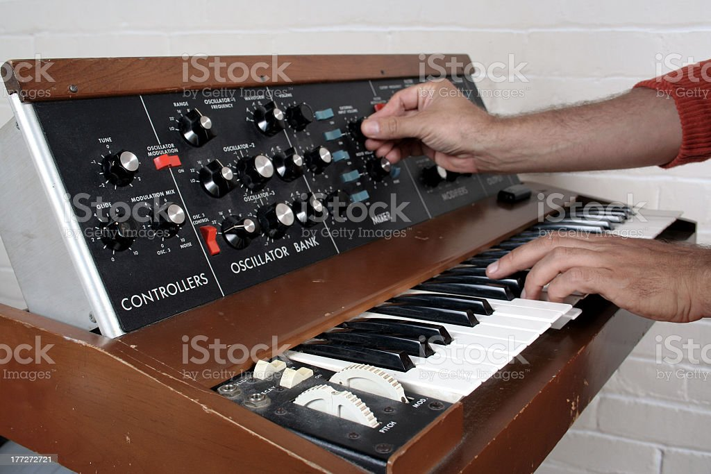 Vintage musical keyboard with piano keys and dial controls stock photo