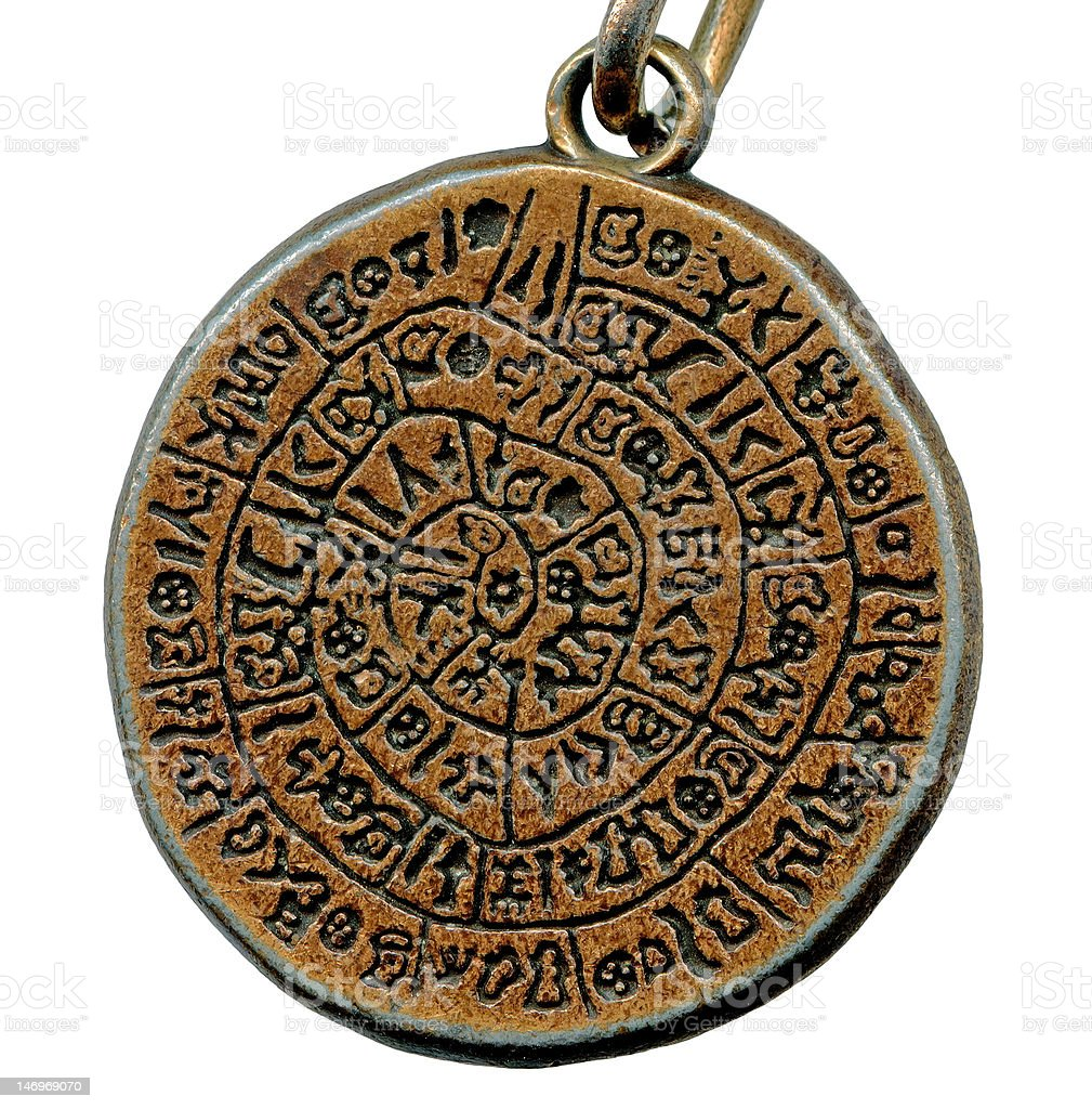 Vintage mystery amulet from old metal isolated on white background stock photo